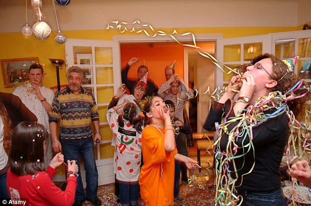 people blowing streamers at a house party