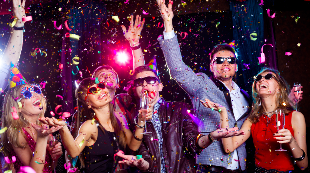 image of new year party goers dancing in confetti