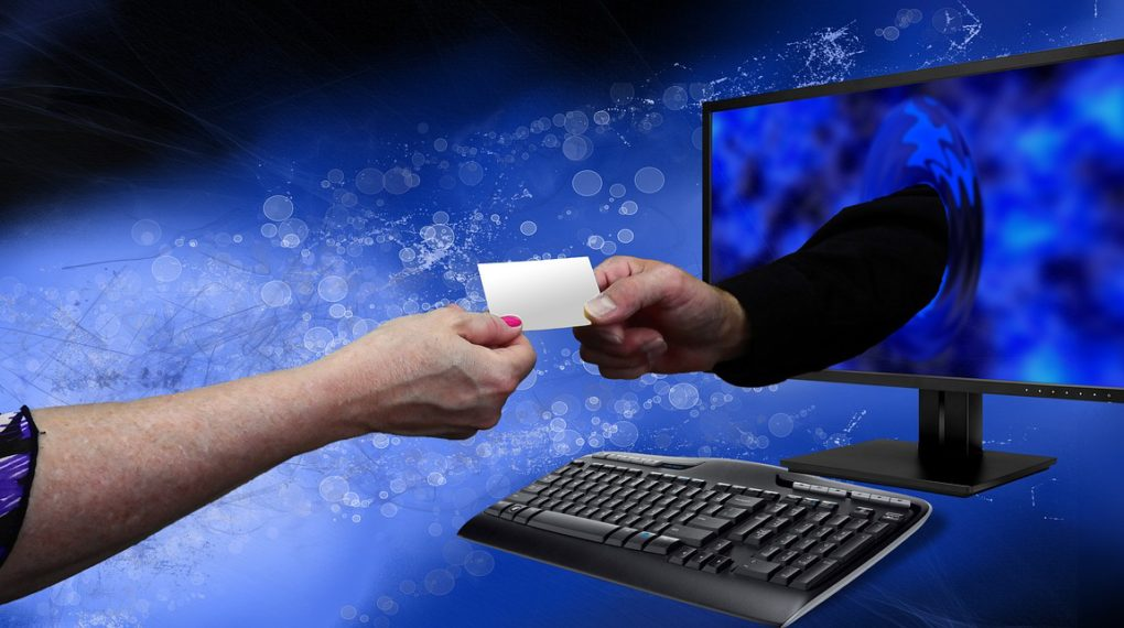featured image showing people exchanging card details online