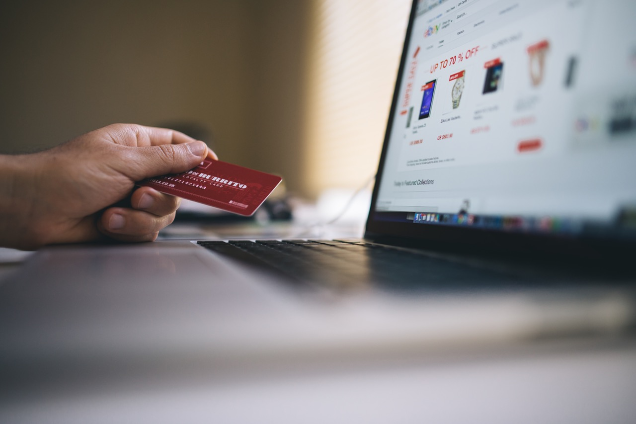 credit card in front of screen
