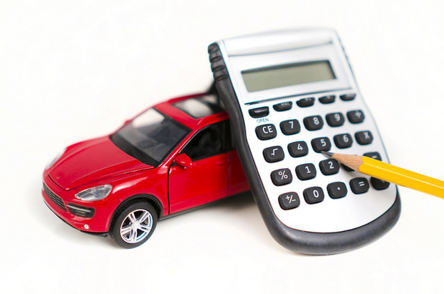 picture of red car and calculator