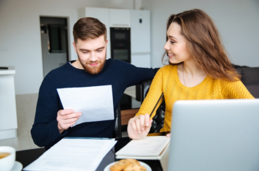 couple looking happy after tax resolution was a success